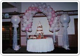 Balloon Arch Over Wedding Cake